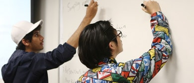 students on whiteboard