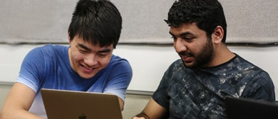 two students on laptop